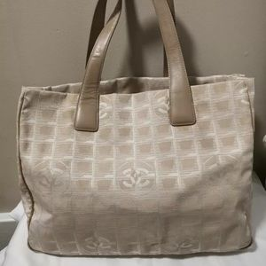 494cd90ff3ebd1 CHANEL. Authentic CHANEL Canvas Travel Tote Bag